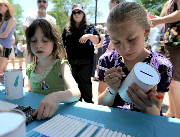 """Leah Ratzlaff (right), 9, and Sarah Rittenhouse (left), 6, work on Tzedakah boxes during the Jewish Festival on the Pearl Street Mall in Boulder, Colorado June 12, 2011.  CAMERA/Mark Leffingwell<br /> <br /> Watch video from the Jewish Festival at  <a href=""""http://www.dailycamera.com"""">http://www.dailycamera.com</a>"""