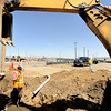 "Precision Directional Drilling employee Justin Coutts waits for more instructions while relocating a telephone pole on Friday, April 6, at the future site of the Boulder Junction apartments at 3100 Pearl Street. For more photos of the construction go to  <a href=""http://www.dailycamera.com"">http://www.dailycamera.com</a> Jeremy Papasso/ Camera"