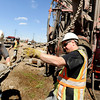 "Kelley Dewatering employees Jerry Tucker, left, Alex Tucker and Dwayne Simpson, right, work to attach a drill to a truck while working to remove excess water located underground on Friday, April 6, at the future site of the Boulder Junction apartments at 3100 Pearl Street. For more photos of the construction go to  <a href=""http://www.dailycamera.com"">http://www.dailycamera.com</a> Jeremy Papasso/ Camera"