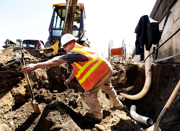 """Precision Directional Drilling employee Jeremiah Cunningham works to relocate a telephone pole on Friday, April 6, at the future site of the Boulder Junction apartments at 3100 Pearl Street. For more photos of the construction go to  <a href=""""http://www.dailycamera.com"""">http://www.dailycamera.com</a> Jeremy Papasso/ Camera"""