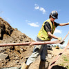 "Kelley Dewatering employee Alex Tucker positions a hose while drilling out excess water on Friday, April 6, at the future site of the Boulder Junction apartments at 3100 Pearl Street. For more photos of the construction go to  <a href=""http://www.dailycamera.com"">http://www.dailycamera.com</a> Jeremy Papasso/ Camera"