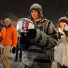Steve Kluck, center, was among the 15 participants in the march.<br /> A candlelight march was held on Pearl Street Sunday evening calling for President Obama to lead the world toward a strong climate agreement at the U.N. International Climate Talks in Copenhagen.<br /> Cliff Grassmick / December 6, 2009