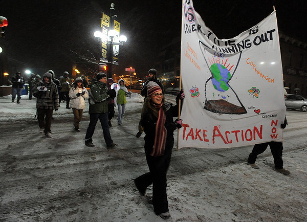 About 15 people participated in a candlelight march that  was held on Pearl Street Sunday evening calling for President Obama to lead the world toward a strong climate agreement at the U.N. International Climate Talks in Copenhagen.<br /> Cliff Grassmick / December 6, 2009