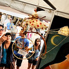"""Victor Ortiz and his wife Monse Ortiz, of Boulder, left, check out a cool art piece by Armando Adrian-Lopez on Saturday, July 16, during the Open Arts Festival on the Pearl Street Mall in Boulder. For more photos and video of the festival go to  <a href=""""http://www.dailycamera.com"""">http://www.dailycamera.com</a><br /> Jeremy Papasso/ Camera"""