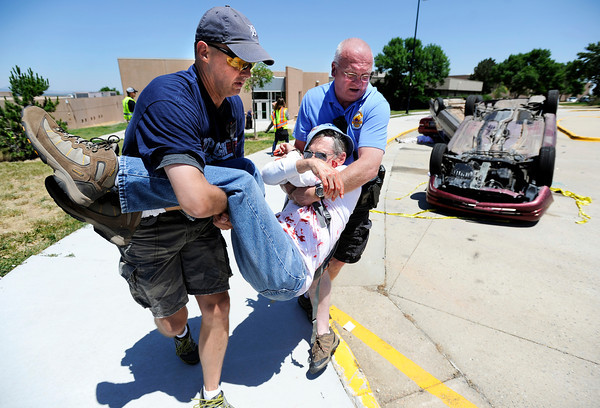 "Boulder Police Officers Mark Niedzielski, left, and Tony DiGiovanni carry an explosion victim away from the scene during a training exercise for the Boulder Police Department on Thursday, June 21, at Fairview High School in Boulder. For more photos and video of the training exercise go to  <a href=""http://www.dailycamera.com"">http://www.dailycamera.com</a><br /> Jeremy Papasso/ Camera"