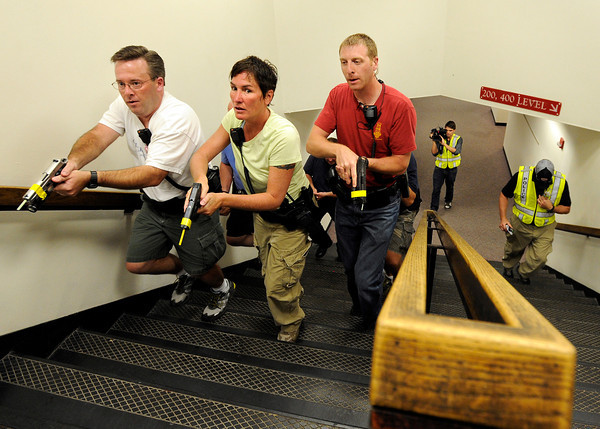 "Boulder Police Officers Nate Smith, left, Liz Ward and Ben Graff walk up a set of stairs while securing the building and looking for a suspect during a training exercise for the Boulder Police Department on Thursday, June 21, at Fairview High School in Boulder. For more photos and video of the training exercise go to  <a href=""http://www.dailycamera.com"">http://www.dailycamera.com</a><br /> Jeremy Papasso/ Camera"