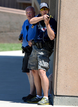"Boulder Police Officers Mark Niedzielski, front, and Tony DiGiovanni work to secure the perimeter during a training exercise for the Boulder Police Department on Thursday, June 21, at Fairview High School in Boulder. For more photos and video of the training exercise go to  <a href=""http://www.dailycamera.com"">http://www.dailycamera.com</a><br /> Jeremy Papasso/ Camera"