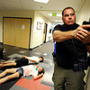 "Boulder Police Officer Shane Rodgers, right, works with his team to secure the building during a training exercise for the Boulder Police Department on Thursday, June 21, at Fairview High School in Boulder. For more photos and video of the training exercise go to  <a href=""http://www.dailycamera.com"">http://www.dailycamera.com</a><br /> Jeremy Papasso/ Camera"
