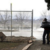 20120222-boulder-res.jpg Blair Salley holds onto his hat as photographs the spray blowing off Coot Lake Wednesday, Feb. 22, 2012.<br /> (Matthew Jonas/Times-Call)