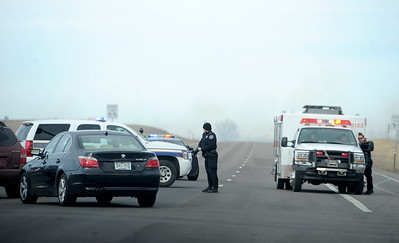 Smoke can be seen looking Longmont-bound on the Diagonal highway from a brush fire. The highway was closed. High wind gusts along Highway 119 from Boulder to Longmont resulted in overturned trucks and a grass fire on February 22, 2012. Cliff Grassmick / February 22, 2012