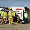 20120222_TRUCK_ROLL_OVER.jpg Boulder Rural Fire Protection District firefighters work to free a driver of a tractor trailer blown over by high winds on the westbound lanes of Diagonal Highway west of Jay Road on Wednesday afternoon.<br /> (Matthew Jonas/Times-Call)