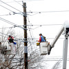 Power company employees work on a series of lines in an area of fallen power poles on 19th Street in Boulder on Wednesday afternoon. <br /> Photo by Paul Aiken