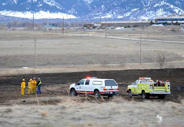 20120222_WILDFIRE_06.jpg Wildland firefighters investigate the burned area in a field near IBM Wednesday, Feb. 22, 2012.<br /> (Matthew Jonas/Times-Call)
