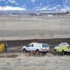 20120222_WILDFIRE_06.jpg Wildland firefighters investigate the burned area in a field near IBM Wednesday, Feb. 22, 2012.<br /> (Matthew Jonas/Times-Call)