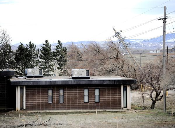 20120222-powerlines.jpg Power lines suspected of starting a wild fire lean near a structure on 63rd Street near Boulder Wednesday, Feb. 22, 2012. (Matthew Jonas/Times-Call)