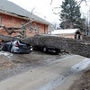 "Greg Rossin was called by roommates to come home to see his ""totaled"" car. High winds blew over this tree at 802 University.<br /> For a video of Rossin, go to  <a href=""http://www.dailycamera.com"">http://www.dailycamera.com</a>.<br /> Cliff Grassmick / February 22, 2012"