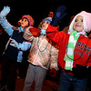 Adelaide Obert, 4, right, Ruby Lortie, 5, and Delaney Watson, 4, smile and wave to Santa on Saturday, Dec. 4, during Boulder's Lights of December Parade in downtown Boulder.<br /> Jeremy Papasso/Camera