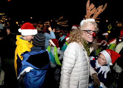 Megan Barksdale, of Boulder, and her child Elke Roemer, 9, right, show their Christmas spirit on Saturday, Dec. 4, during Boulder's Lights of December Parade in downtown Boulder. Jeremy Papasso/Camera