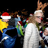 Megan Barksdale, of Boulder, and her child Elke Roemer, 9, right, show their Christmas spirit on Saturday, Dec. 4, during Boulder's Lights of December Parade in downtown Boulder.<br /> Jeremy Papasso/Camera