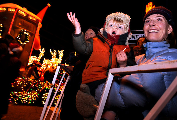 Cathy Pacocha and her son Jack, of Boulder, smile as they got their first look at Santa on Saturday, Dec. 4, during Boulder's Lights of December Parade in downtown Boulder.<br /> Jeremy Papasso/Camera