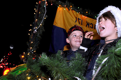 Otto VanMaarth, 8, right, and Pete Burk, 7, show their Christmas spirit on Saturday, Dec. 4, while riding on the Cub Scout Pack 171 float during Boulder's Lights of December Parade in downtown Boulder. Jeremy Papasso/Camera
