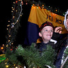 Otto VanMaarth, 8, right, and Pete Burk, 7, show their Christmas spirit on Saturday, Dec. 4, while riding on the Cub Scout Pack 171 float during Boulder's Lights of December Parade in downtown Boulder.<br /> Jeremy Papasso/Camera