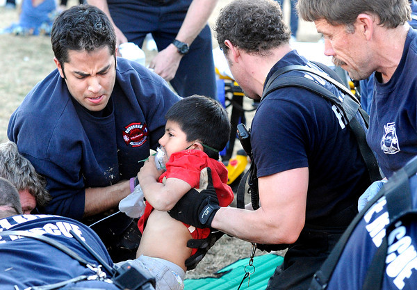 """Boulder Fire Rescue, EMS and the Boulder Police Department work to rescue a five-year-old boy from a hole that he fell into at 3025 Littleleaf Ln. in Boulder on Thursday, March 22. The boy was transported to Foothills Community Hospital. For a video and more photos of the scene go to  <a href=""""http://www.dailycamera.com"""">http://www.dailycamera.com</a><br /> Jeremy Papasso/ Camera"""