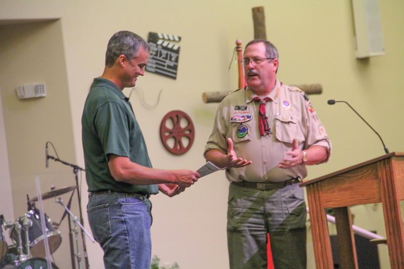 ALEC SMITH / GAZETTE Boy Scout Troop 501 Scoutmaster David Marvinney is shown Saturday with Brett Rabung, associate pastor at Medina United Methodist Church. Rabung received a thank-you certificate for the troop sponsorship. The troop celebrated its 90th anniversary Saturday. A tree will be presented to the church.