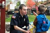 KELLY FLETCHER, REFORMER CORRESPONDENT -- Nathan Powers hold up the candy he picked out of a bag offered by firefighter Brody Burke at the Brattleboro FIre Station during BrattleBOO festivities.