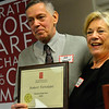 KRISTOPHER RADDER — BRATTLEBORO REFORMER<br /> Vickie Case presents Robert Tortolani an award for Person of the Year during the Brattleboro Area Chamber of Commerce's Annual Meeting on Thursday, Jan. 24, 2019.