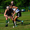 KRISTOPHER RADDER — BRATTLEBORO REFORMER<br /> Brattleboro's Lily Puintaro gets the ball away from Burr and Burton's Riley Callen during a field hockey game at Brattleboro on Monday, Sept. 16, 2019.