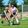 KRISTOPHER RADDER — BRATTLEBORO REFORMER<br /> Brattleboro's Krista Kinley gets the ball away from the goal while being chases by Burr and Burton's Celsey McMahon during a field hockey game at Brattleboro on Monday, Sept. 16, 2019.