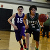 KRISTOPHER RADDER - BRATTLEBORO REFORMER<br /> Leland & Gray's Teresa Derosia gets past Brattleboro's Kyle Simuro during a unified basketball game on Monday, April 2, 2018.