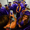 KRISTOPHER RADDER - BRATTLEBORO REFORMER<br /> Assistant principal Kate Margaitis takes a photo of Tanner Bell before commencement at Brattleboro Union High School on Friday, June 16, 2017.