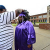 KRISTOPHER RADDER - BRATTLEBORO REFORMER<br /> Tary Mitchell places the tassel onto the cap of his daughter Tatiahna before commencement at Brattleboro Union High School on Friday, June 16, 2017.