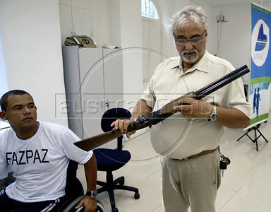 Luiz Carlos Silveira, member of Viva Rio NGO, reviews guns that were collected on a national disarmament campaign, at Viva Rio ONG, Rio de Janeiro, Brazil, May 12, 2011. The Brazilian government has begun a disarmament campaign officials hope will take more than 1 million guns off the streets by the end of the year. (Austral Foto/Renzo Gostoli)