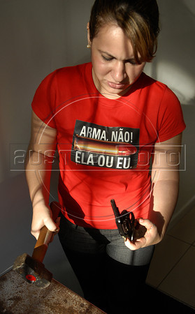 Raquel de Oliveira, member of Viva Rio NGO, destroys guns that were collected on a national disarmament campaign, at Viva Rio ONG, Rio de Janeiro, Brazil, May 12, 2011. The Brazilian government has begun a disarmament campaign officials hope will take more than 1 million guns off the streets by the end of the year. (Austral Foto/Renzo Gostoli)