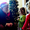 Juniper Chappell, 4, talks with Santa.