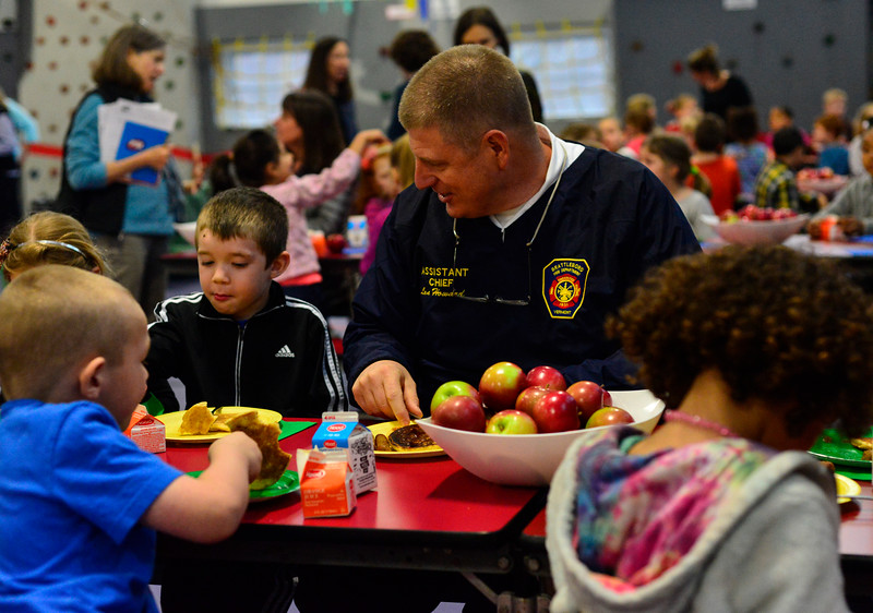 KRISTOPHER RADDER - BRATTLEBORO REFORMER<br /> Brattleboro Assistant Fire Chief Lenny Howard talks with Jace Smith, a kindergartner at Academy School, during a breakfast at the school with first responders on Wednesday, April 25, 2018.