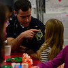 KRISTOPHER RADDER - BRATTLEBORO REFORMER<br /> Brattleboro Police Capt. Mark Carignan talks with Isabella Griffth during a breakfast at the school with first responders on Wednesday, April 25, 2018.