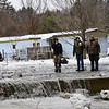 KRISTOPHER RADDER — BRATTLEBORO REFORMER<br /> People watch as crews remove the ice jam from the Whetstone Brook on Friday, Jan. 25, 2019.