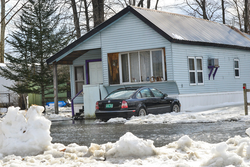 KRISTOPHER RADDER — BRATTLEBORO REFORMER<br /> Water from the Whetstone Brook poured into parts of Mountain Home Park, in West Brattleboro,  causing seven people to be evacuated.