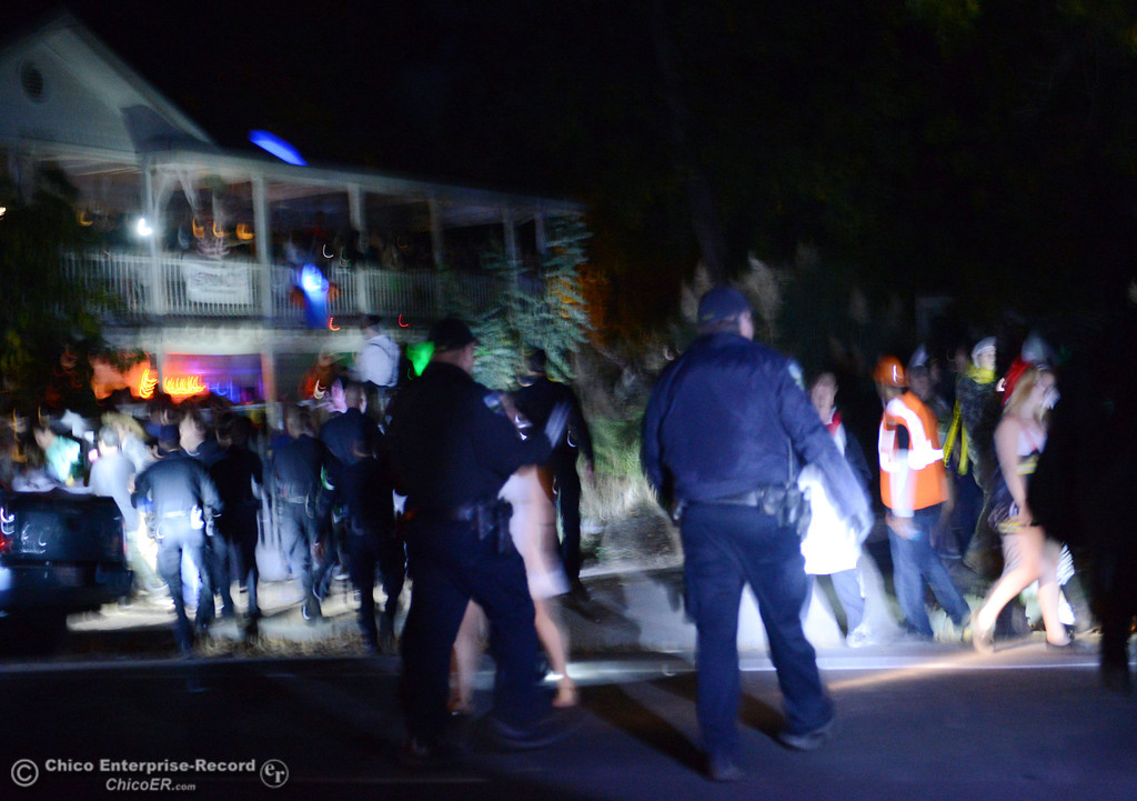 . Chico Police responded an anonymous call about two large parties of up to 1000 people next to each other along W. 9th St and Normal Ave Friday, November 1, 2013 in Chico, Calif. People were jumping from the second story before police came and broke up the party.  (Jason Halley/Chico Enterprise-Record)