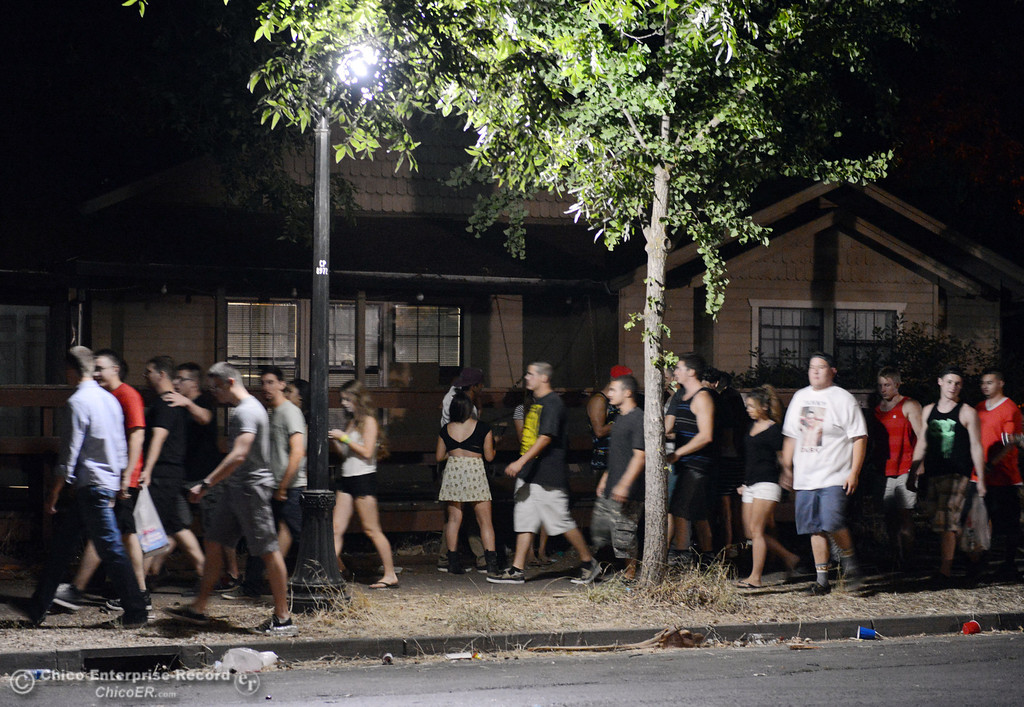 . A crowd moves north along Ivy St. near W. 7th St. as Chico Police responded to large incidents in the south campus area Friday, August 23, 2013 in Chico, Calif.  (Jason Halley/Chico Enterprise-Record)