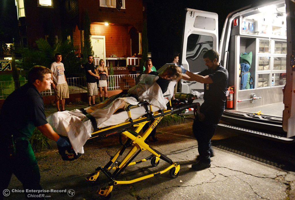 . A man of legal age, who was allegedly intoxicated, is transported to Enloe Medical Center as Chico Police responded to large incidents in the south campus area Friday, August 23, 2013 in Chico, Calif.  (Jason Halley/Chico Enterprise-Record)