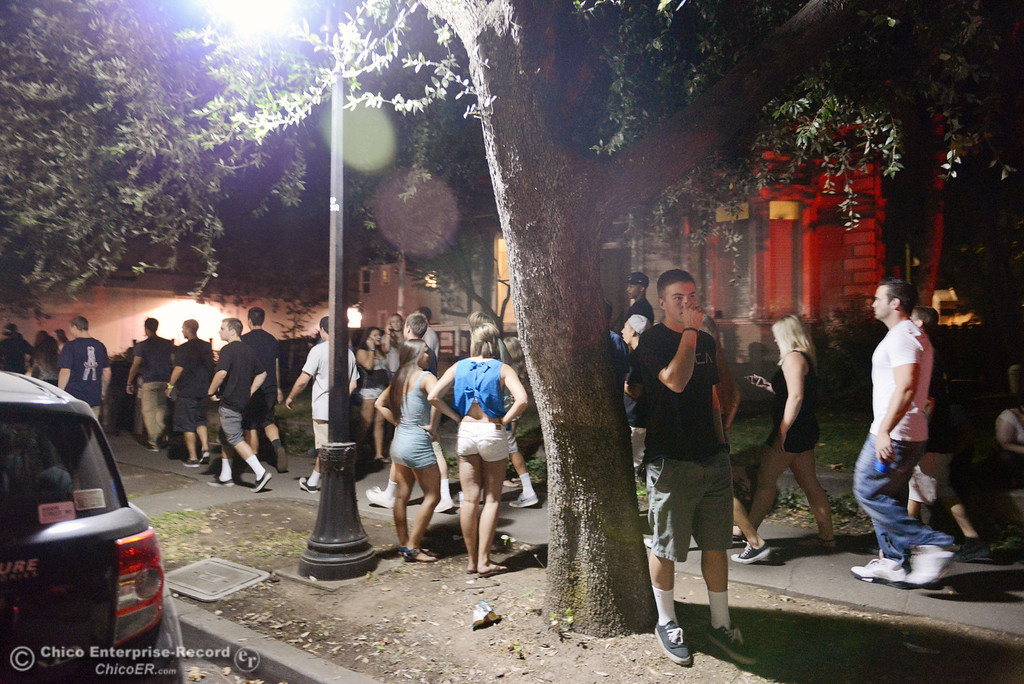 . A crowd moves north along Ivy St. near W. 6th St. as Chico Police responded to large incidents in the south campus area Friday, August 23, 2013 in Chico, Calif.  (Jason Halley/Chico Enterprise-Record)