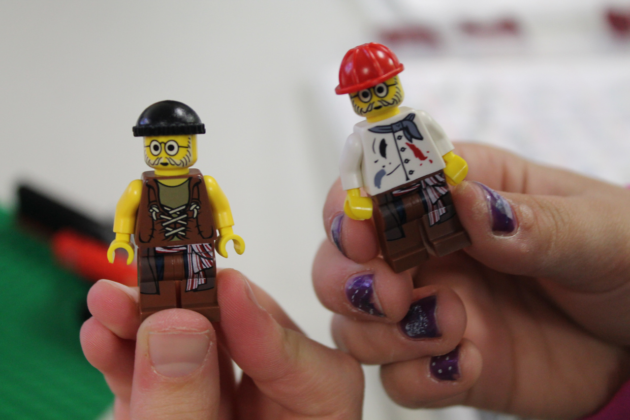 """LAWRENCE PANTAGES / GAZETTE Lego people figures are shown by children ages 6-12 who were in a """"camp"""" at the Bricks4Kidz location in Medina on Tuesday enjoying various activities during spring break from school."""
