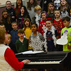 """KRISTOPHER RADDER — BRATTLEBORO REFORMER<br /> Music teacher Rita Corey, left, directs the students at the Dummerston School in a rehearsal for their upcoming show titled """"Bring on the Snow"""" on Tuesday, Dec. 11, 2018."""