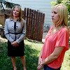 "Brittany Moore, right, listens to her attorney, Jennifer Edwards, during a press briefing at her home in Erie.<br /> Attorneys with the Animal Law Center announced they have filed a lawsuit against the town of Erie and Erie police Officer Jamie Chester on behalf of Brittany Moore, whose dog was shot and killed by Chester in 2011<br /> For more photos and a video of Moore, go to  <a href=""http://www.dailycamera.com"">http://www.dailycamera.com</a>.<br /> Cliff Grassmick / July 5, 2012"