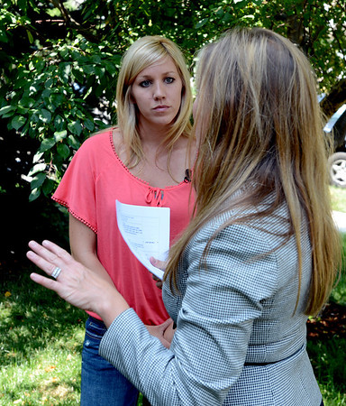 "Brittany Moore, left, talks to her attorney, Jennifer Edwards, during a press briefing at her home in Erie.<br /> Attorneys with the Animal Law Center announced they have filed a lawsuit against the town of Erie and Erie police Officer Jamie Chester on behalf of Brittany Moore, whose dog was shot and killed by Chester in 2011<br /> For more photos and a video of Moore, go to  <a href=""http://www.dailycamera.com"">http://www.dailycamera.com</a>.<br /> Cliff Grassmick / July 5, 2012"
